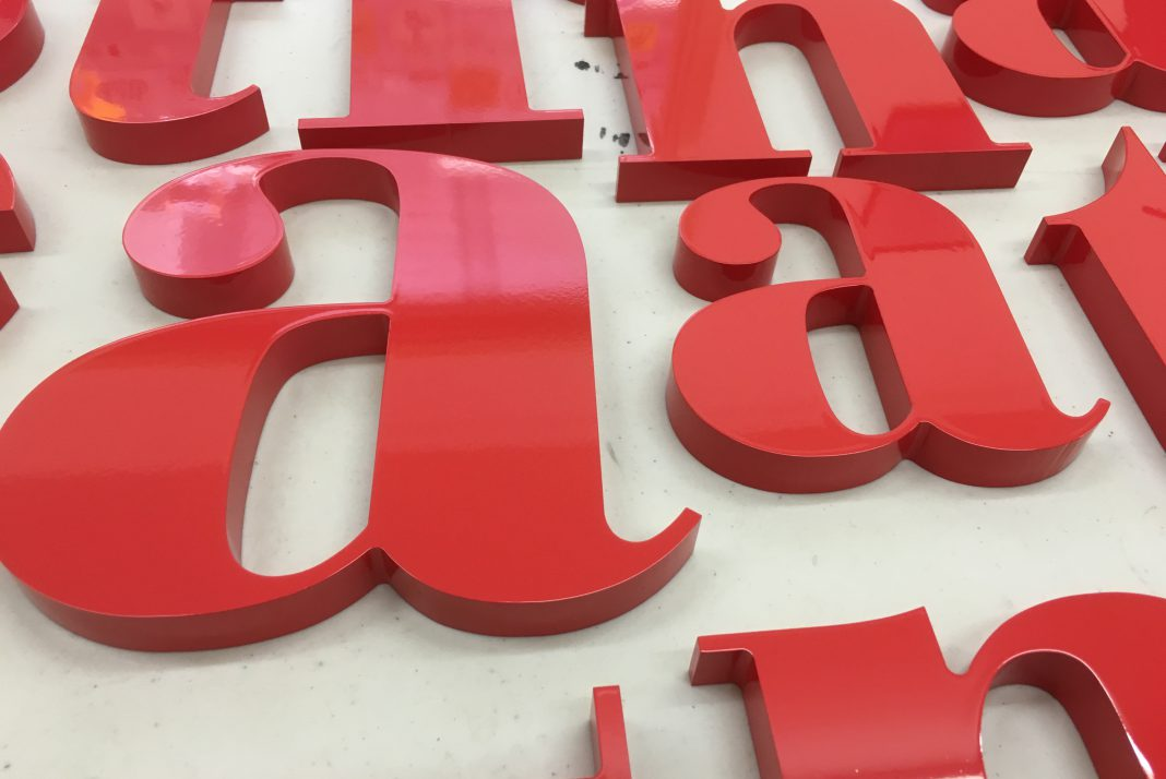 Custom profile cut and painted MDF lettering